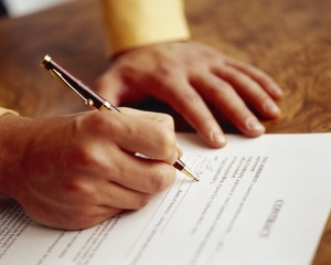 Hands of man signing contract